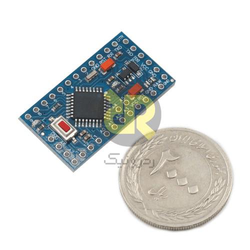 مقایسه اندازه آردوینو Pro Mini با یک سکه